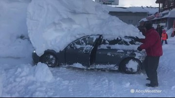 Driver reverses car while under 6ft-high snow mound