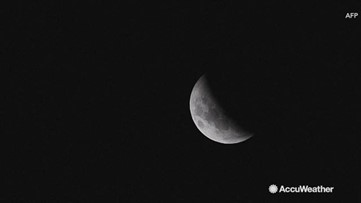 Total lunar eclipse darkens night sky