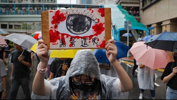 Police, protesters skirmish in Hong Kong after march
