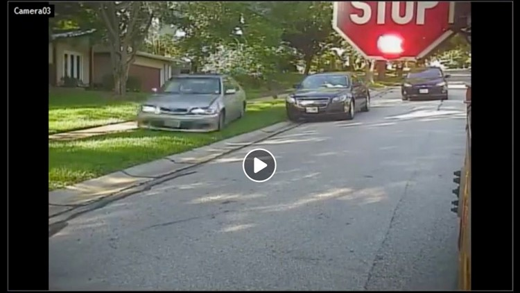 A man has been arrested after video appears to show him speeding through a yard, ignoring a school bus stop arm near an elementary school in Missouri.