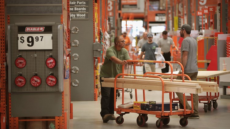 Customers shop at a Home Depot store on July 26, 2017 in Chicago, Illinois.