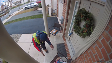 Watch: Amazon delivery worker surprised with free basket of treats on porch