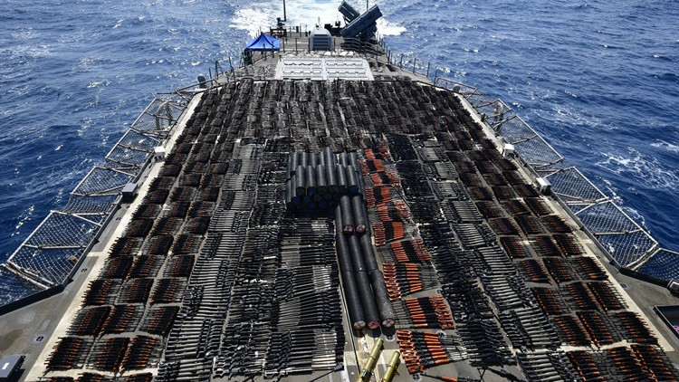 Thousands of illicit weapons seized by Navy guided-missile cruiser cover warship's deck