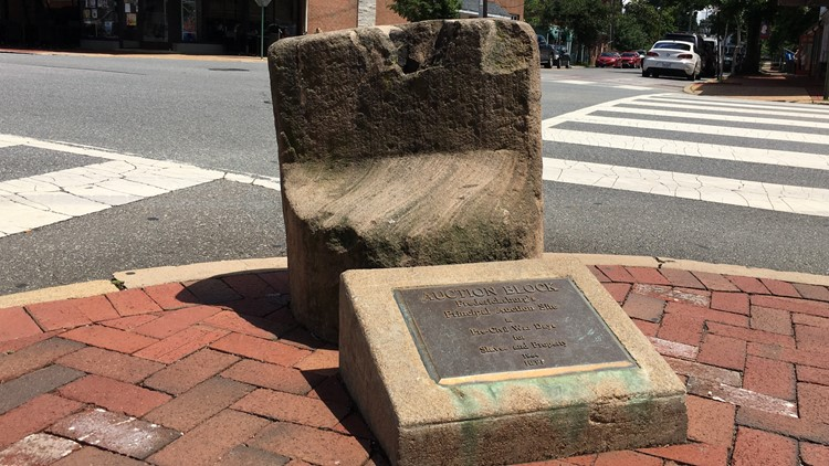 'It's like a trophy for racist folks' | Why a historic slave auction block is moving from its Fredericksburg street corner