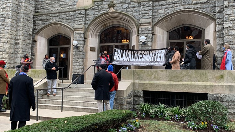 DC's oldest Black church hangs new Black Lives Matter banner after it was burned during MAGA protest