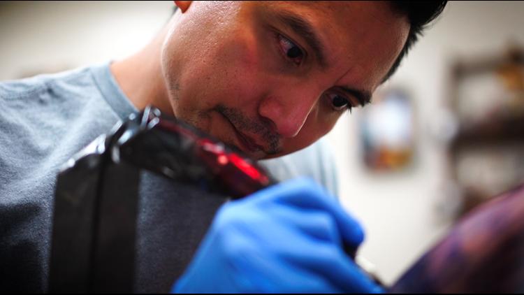 Chris Garcia tattooing