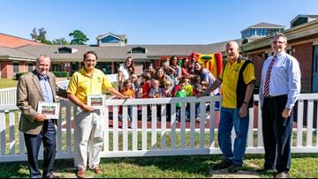 Smithfield Lion's Club pays for new fence at Carrollton Elementary School's preschool playground