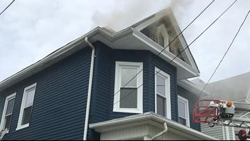 Crews battle fire inside home's attic in Norfolk