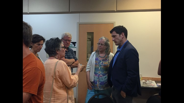 Rep. Scott Taylor, far right, speaks with constituents before the annual State of Our Waters event on Thursday, May 31, 2018 in Melfa, Virginia.