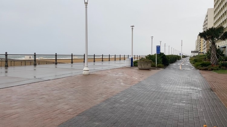 'Just praying for clear skies' | Vacationers at the Oceanfront rained out as Elsa moves through