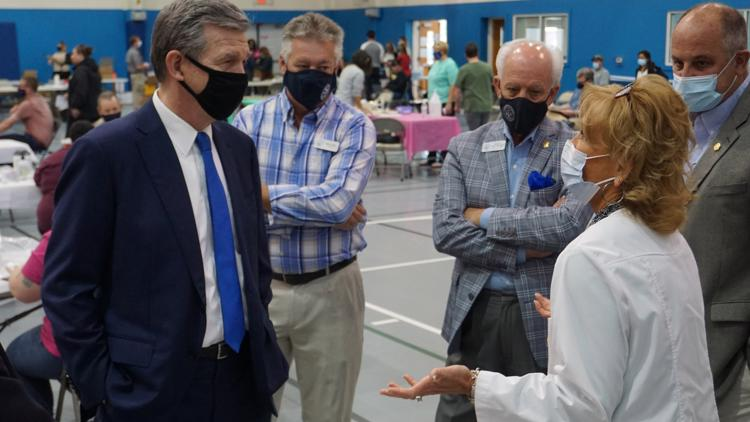 Gov. Roy Cooper tours Dare County vaccination site, urges people to get vaccinated ahead of tourist season
