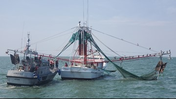 US Coast Guard medevac man from fishing boat in Pamlico Sound, NC