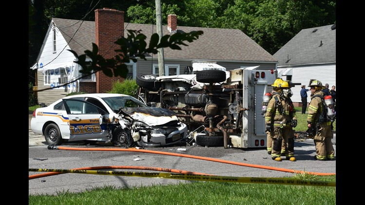 A Portsmouth Police officer was injured in a two-car crash Thursday afternoon.
