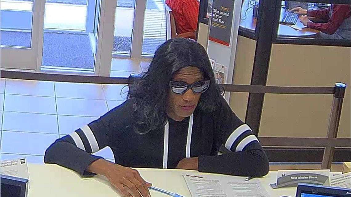 man dressed in wig  women u0026 39 s clothing robs bank in