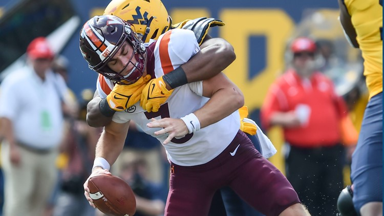 WVU builds big lead, holds on to topple #15 Va Tech 27-21