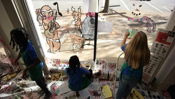 Suffolk students paint downtown storefronts for the holidays