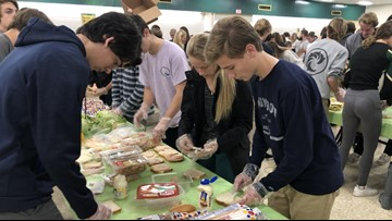 IN SESSION: Virginia Beach students pack thousands of lunches for the homeless