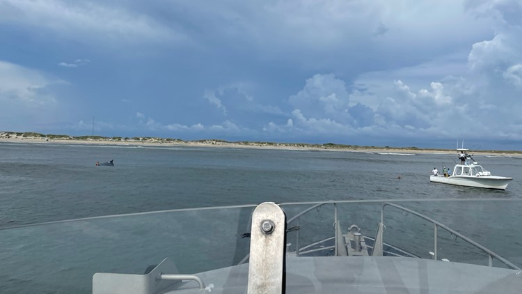 PHOTOS: 3 rescued from Oregon Inlet after boat capsizes