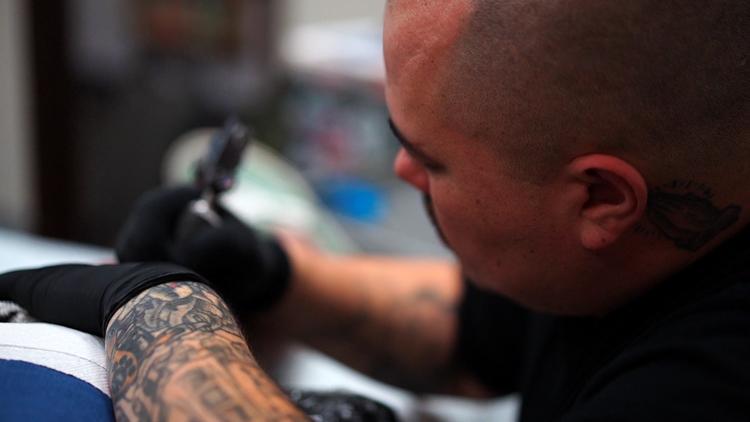 Carl tattooing
