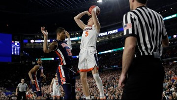 Guy hits FTs on disputed foul, Virginia survives vs Auburn 63-62