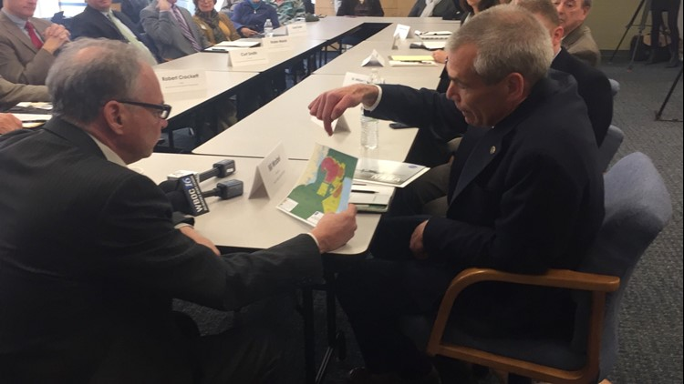 Bill Wrobel, director of NASA Wallops Flight Facility, shows Sen. Tim Kaine a map of rocket launch hazard zones during a roundtable discussion about offshore oil drilling at the Va. Institute of Marine Science Eastern Shore Laboratory in Wachapreague