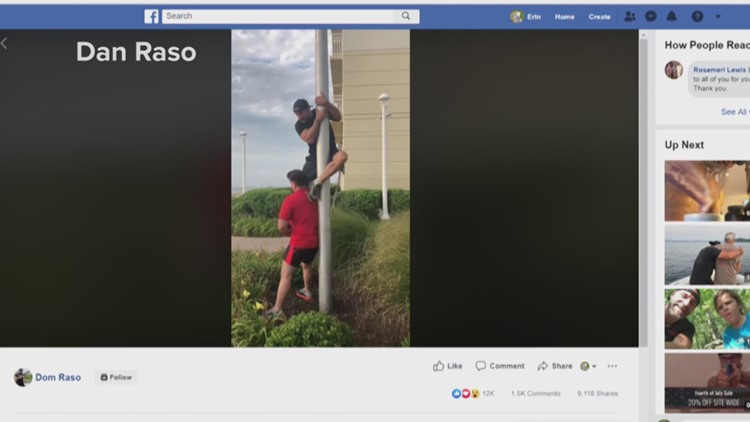 Navy SEAL climbs flag pole at Virginia Beach Oceanfront