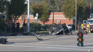Driver dies after truck crashes into several poles, catches fire in Norfolk