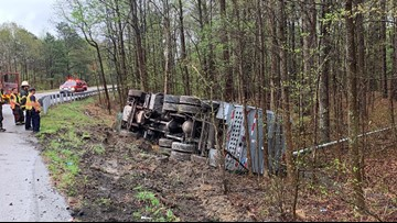 State police investigate tractor-trailer flipped on I-64