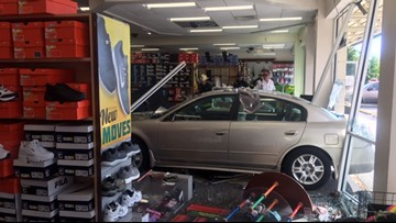Two injured after car crashes into Shoe Dept. in downtown Suffolk