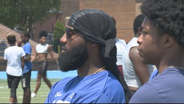 Ex-NFL great Hall passing on wisdom at the HRYF Camp
