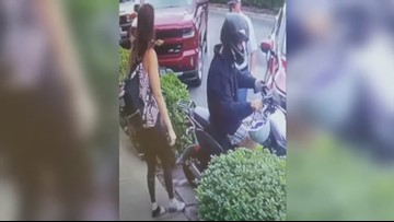 Surveillance video: 'Bonnie and Clyde' thrift store robbers