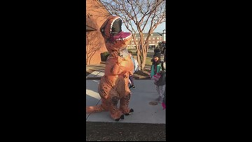 Dinosaur greets Centerville Elementary School students for book fair