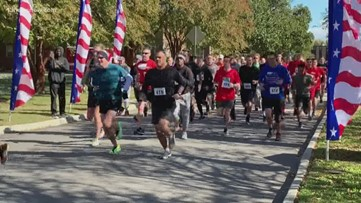 More than 300 runners honored Navy's Wounded Warrior program