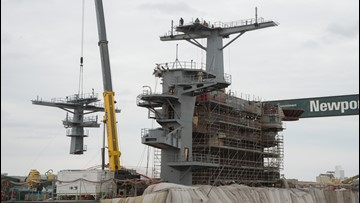 New main mast installed on USS George Washington