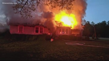 Dog alerts owners that neighbor's Suffolk house caught fire