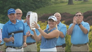 Law holds off the field for 1st career LPGA win by taking the Pure Silk Championship